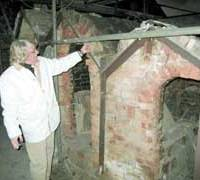 Harry Isaacs, mayor of St. Ives, southwest England, shows off the kiln used by the late British potter Bernard Leach (below left) at his studio in this Cornish town.