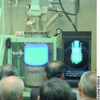 A replica of a uranium solution settling tank that was the site of the nation's worst nuclear accident is unveiled in the village of Tokai, Ibaraki Prefecture.
