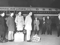 Japanese Red Army Faction members who hijacked a Japan Airlines jetliner arrive in Pyongyang on April 3, 1970. Below, Shinji Ishida, pilot of the hijacked airplane, smiles at well-wishers after returning the next day to Tokyo's Haneda airport.