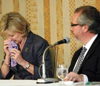 Slain Briton Lucie Blackman's mother, Jane Steare, wipes away tears as her husband, Roger, looks on during a news conference in Tokyo.