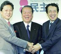 Democratic Party of Japan executives Secretary General Yukio Hatoyama, President Ichiro Ozawa and Vice President Naoto Kan celebrate Sunday at party headquarters in Tokyo after their candidate's victory in the Chiba by-election.