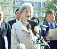 Sakie Yokota, whose daughter, Megumi, was abducted by Pyongyang, speaks to reporters Wednesday in Washington after meeting with Deputy National Security Adviser Jack Crouch.