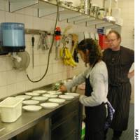 Maggie Beyne dishes out desserts at a vocational training center in Amsterdam.