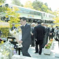 Relatives of victims of a fatal train collision in 1991 and JR West officials hold a memorial service Sunday in Koka, Shiga Prefecture, on the 15th anniversary of the accident.