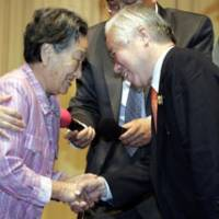 Shigeru Yokota, whose daughter was abducted to North Korea, is greeted Tuesday in Seoul by Choi Gye Wol, whose son, Kim Young Nam, is also believed to have been kidnapped by the North and may have been his daughter's husband.