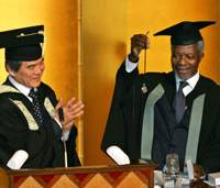 U.N. Secretary General Kofi Annan holds up a pocket watch he received from University of Tokyo President Hiroshi Komiyama, during a university ceremony Thursday in Tokyo to confer an honorary degree on him.