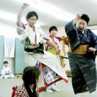 Natsuki Tsukamoto, 12, (standing, left) practices for a play that will be performed this August in Tokyo and Osaka.