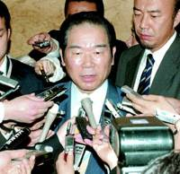 Defense Agency chief Fukushiro Nukaga speaks to reporters after a Cabinet meeting Tuesday morning.