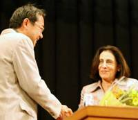 Film Director Makoto Sato shakes hands with Mariam Said, widow of controversial Palestinian-American intellectual Edward Said, at the Tokyo launch of Sato's new documentary 'Out of Place' in April.