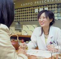 An adviser holds consultations on 'kampo' Chinese herbal medicine with a customer at Nihondo Co. in Minato Ward, Tokyo.