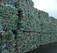 A Japantech Co. employee views huge piles of used plastic bottles in a stockyard at the company's main factory.