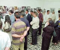 People look at displays about the atomic bombs dropped on Hiroshima and Nagasaki at an exhibition in Arbil, Iraq, on Tuesday.