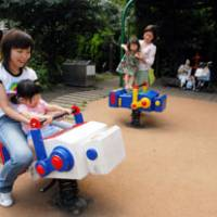 Mothers and children romp in the Roppongi Hills playground in Tokyo's Minato Ward.