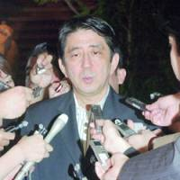 Chief Cabinet Secretary Shinzo Abe speaks to reporters Thursday following a televised news conference held in North Korea by a South Korean man who is apparently the former husband of Japanese abductee Megumi Yokota. | KYODO PHOTO