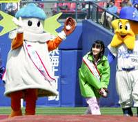 Rina Suzuki (second from right) encourages fans at a preseason game at Yokohama Stadium to vote in the city's mayoral election held last March 26.   KYODO PHOTO