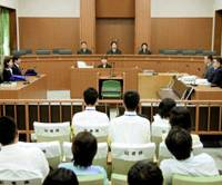 Judges preside over a Hiroshima District Court murder trial before handing down a sentence Tuesday. | POOL PHOTO