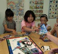 Japanese students of English in Osaka learn both the language and more about Japan while playing JAPAN: The Game, with a native English teacher. | PHOTO COURTESY OF DANIEL JON