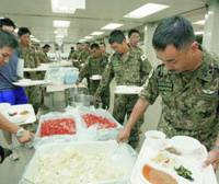 Personnel from the Ground Self-Defense Force hit the chow line at their camp in Samawah, Iraq.   GSDF PHOTO/KYODO