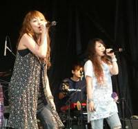 The band Puffy AmiYumi, Ami Onuki (right) and Yumi Yoshimura, put on a concert as part of the River to River Festival in New York City earlier this month. | KYODO PHOTO