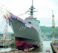 The Atago, Japan's fifth warship with the Aegis defense system, is launched in August 2005 at Mitsubishi Heavy Industries Ltd.'s dockyard in Nagasaki. After it is commissioned next spring it will be based in Maizuru, Kyoto Prefecture. | KYODO PHOTO