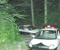Parked police cars mark the area where officers found the bodies of a mother and daughter Tuesday.   KYODO PHOTO
