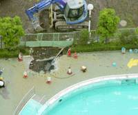 Police conduct an inspection Tuesday morning at the swimming pool where a 7-year-old girl died Monday in Fujimino, Saitama Prefecture. | KYODO PHOTO