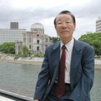 Lee Sil Gun poses at Peace Memorial Park in Hiroshima last month while explaining the situation surrounding North Korean survivors of the atomic bombings. | KYODO PHOTO