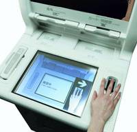 A biometric automated teller machine produced by Hitachi Ltd. scans a person's fingerprint in this undated file photo. | HITACHI LTD. PHOTO/KYODO