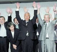 Former Diet member Jin Murai (center) leads a cheer of 'Banzai' with supporters at a hotel in Nagano on Sunday after projections showed he would win the gubernatorial election.   KYODO PHOTO