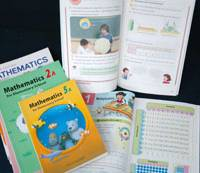 Mathematics textbooks written in English published by major houses Tokyo Shoseki and Gakko Tosho are shown in this undated file photo.   KYODO PHOTO