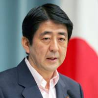Chief Cabinet Secretary Shinzo Abe, the front-runner for the next prime minister, faces reporters last week. | KYODO PHOTOS