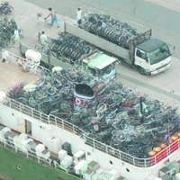 This photo taken in 2003 shows a North Korean freighter packed with used bicycles and sppliances from Japan in Maizuru, Kyoto Prefecture. | KYODO PHOTOS