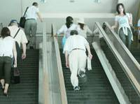 People resort to using escalators as stairways in Shibuya Ward after a blackout hit Tokyo on Monday.