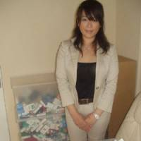 Miho Shimada of Allen Carr Tokyo shows off what she calls a 'tobacco grave,' in which clients threw away their cigarettes after therapy. | JUN HONGO PHOTO