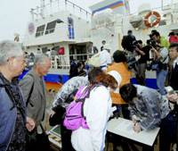 Former residents of Russian-held islands off Hokkaido leave Nemuro port Friday for a visa-free visit to the islands. | KYODO PHOTO