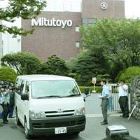 A van carrying confiscated documents leaves Mitutoyo Corp.'s head office in Kawasaki on Friday following a raid by Tokyo police. | KYODO PHOTO