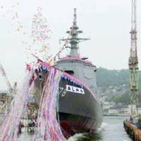 The Aegis Destroyer Ashigara is launched in a Nagasaki shipyard Wednesday.   KYODO PHOTO