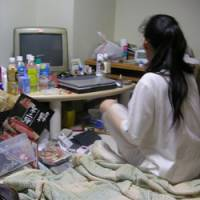 A woman on public assistance sits in her Tokyo flat, feeling little incentive to get off welfare. | KYODO PHOTO