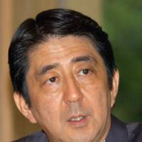 Shinzo Abe gives an interview Wednesday at the prime minister's office. | SATOKO KAWASAKI PHOTO