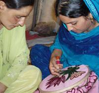 Kashmiri women work on embroidery in this undated photo from the Japan Agency for Development and Emergency. | KYODO PHOTO