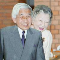 Emperor Akihito and Empress Michiko are all smiles during their Sept. 10 visit to Aiiku Hospital in Tokyo to see Princess Kiko and their newly born grandson. | POOL PHOTO