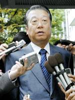 Ichiro Ozawa, president of the Democratic Party of Japan, faces reporters in Tokyo on Tuesday morning.