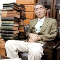 Shigeru Hiyama, a collector of items related to writer Lafcadio Hearn, poses during an interview in Osaka in July. | KYODO PHOTO
