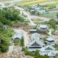 Flooding and landslides caused by Typhoon Shanshan leave a wake of destruction in Karatsu, Saga Prefecture, on Saturday. | KYODO PHOTO
