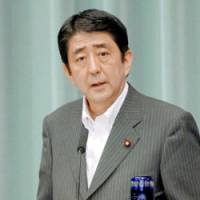 Chief Cabinet Secretary Shinzo Abe announces financial sanctions against North Korea on Tuesday at the Prime Minister's Official Residence.   KYODO PHOTO