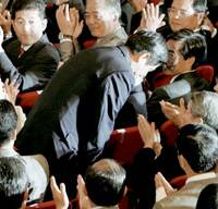 Chief Cabinet Secretary Shinzo Abe bows to Liberal Democratic Party lawmakers Wednesday after being chosen party president.   KYODO PHOTO