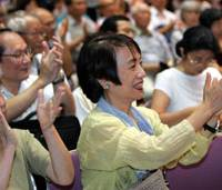 Teachers celebrate a landmark ruling by the Tokyo District Court on Thursday that said they were under no obligation to participate in the singing of 'Kimigayo' at school ceremonies.   AP PHOTO