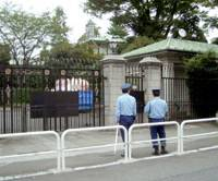 Guards stand in front of the British Embassy in Tokyo's Chiyoda Ward on Friday. | KYODO PHOTO