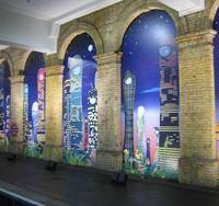 Chiho Aoshima's multipanel 'City Glow, Mountain Whisper' graphic installation lights up the platform at the Gloucester Road subway station in London. | KYODO PHOTO
