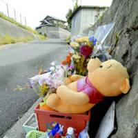 Flowers and toys lie Tuesday at the scene in Heguricho, Nara Prefecture, where 7-year-old Kaede Ariyama was found slain in 2004.